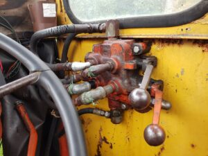 equipment and machinery repair tractor loader hydraulic valve replacement