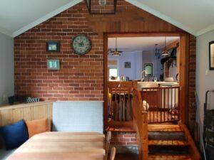 rustic farmhouse reno exposed interior brick custom built in seating